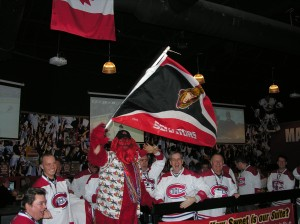 the sensquatch waves the sens flag